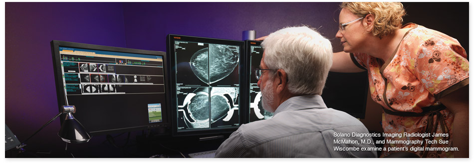 Dr. James McMahon and Sue Wiscombe review a digital mammogram