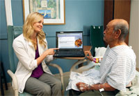 Clinical Dietitian Adrianne Bowen counsels a patient on diet choices.