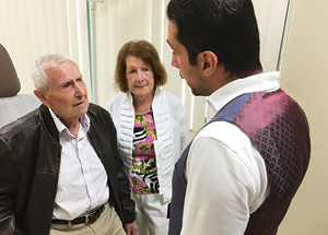 Gerald Simoni and Jean Eldridge listen intently to the advice of Ali Hassani, M.D.
