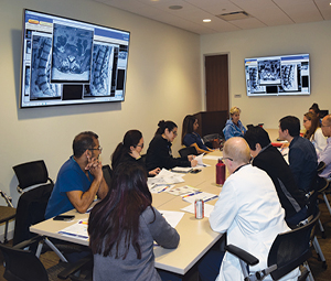 A team of NorthBay Healthcare clinicians from the NorthBay Spine Program regularly confer over cases.