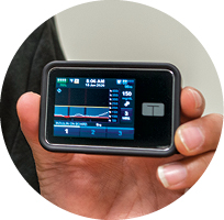An insulin pump displays information on a patient's blood sugar levels.